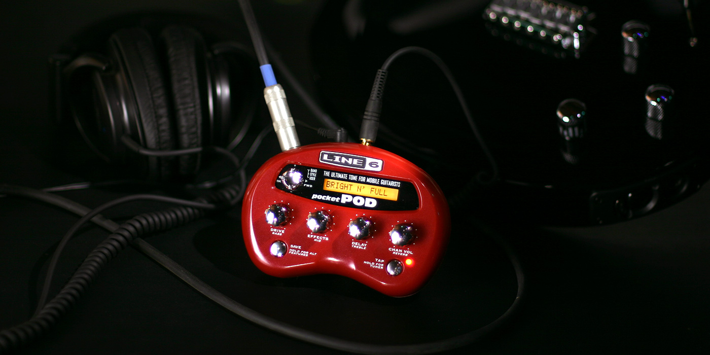 Line 6 Pocket POD product image being used with a Variax and headphones