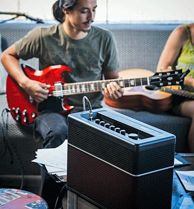 guitar player practicing on Line 6 AMPLIFi amp