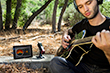 Mike Merrill recording guitar on Line 6 Sonic Port VX audio recording interface to Garageband