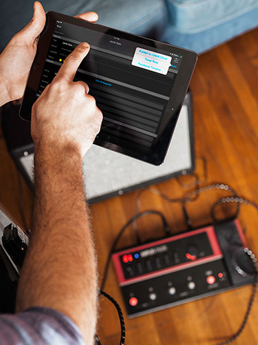 guitarist using Line 6 AMPLIFi Remote app for iOS and Android