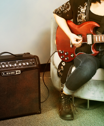 guitar player practicing on Line 6 Spider IV amp