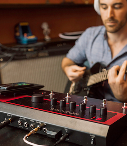 guitarist practicing on Line 6 FX100 guitar effects pedal