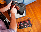 guitarist using Line 6 FX100 guitar effects pedal remote app for iOS and Android
