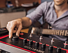 guitar player tweaking tones on Line 6 FX100 guitar effects pedal